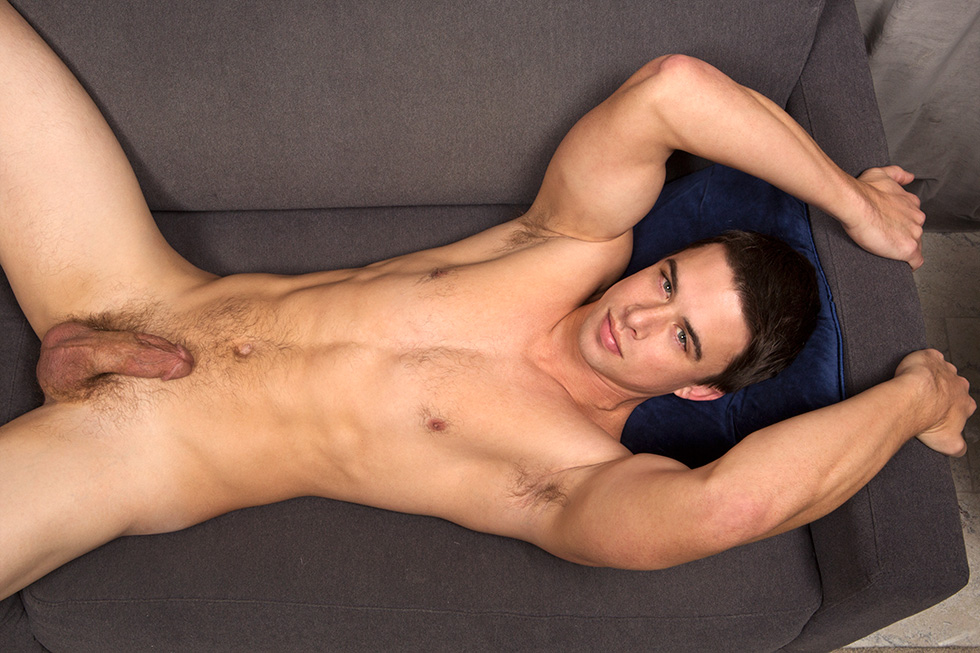 Muscled jock plays with his ass