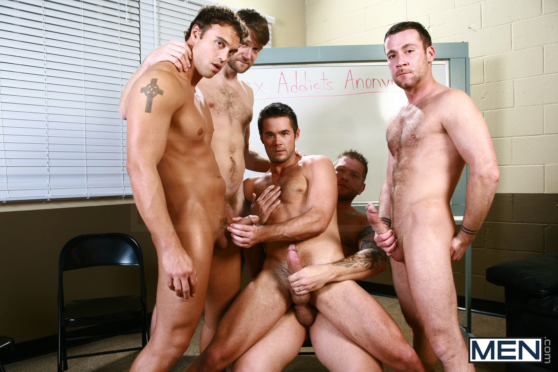Four guys with huge muscles and boners whip them out for gay group sex.